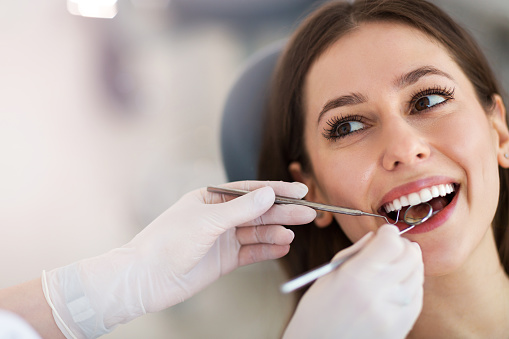 Mercer Island woman smiling at dental cleaning and exam from Dr. Shiotsu